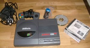 The Amiga CD32, PSU, CD's, RF-cable and joypad (photo by Old School Game Blog)