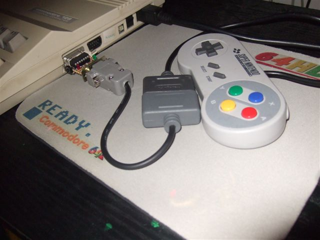 SNES controller hooked up to a Commodore (photo taken from http://www.64hdd.com/64jpx/64jpx.html)