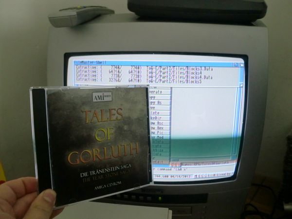 Installing Tales of Gorluth on my Amiga 1200. :) You can see Filemaster in the background uncompressing the .LHA archive.