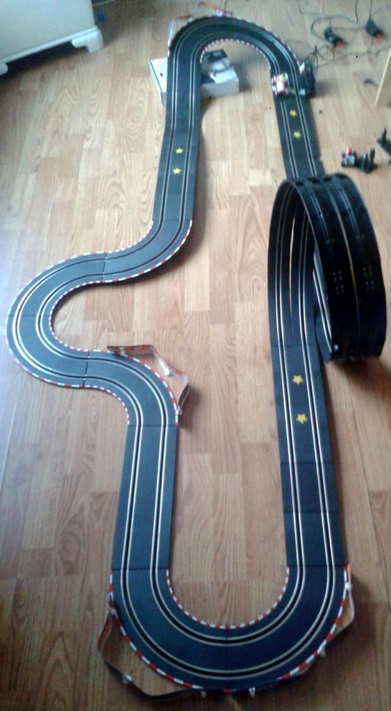 Here's one of the tracks we've built. This one is not as advanced, but very fun to race, especially due to the loop you see back there. There are two lanes, so that we can do two-player mode. This is great fun. :) (photo by Old School Game Blog)