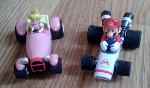Here are the karts. My daughter loves driving the pink one with Princess, while I'm racing with Mario. It is possible to buy more cars and extensions. (photo by Old School Game Blog)