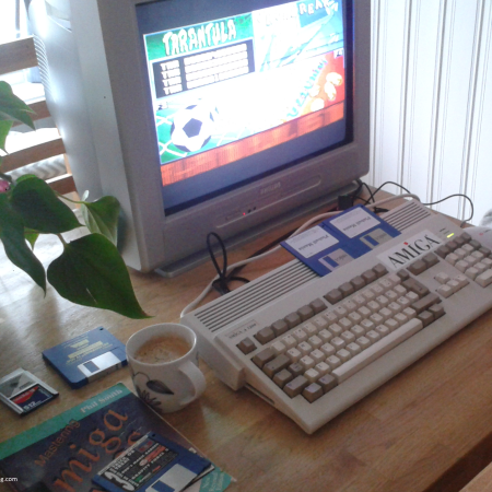 Photo of my Amiga 1200 in action running Pinball Mania. You can also see Phil South's excellent AMOS book on the left hand side. :)